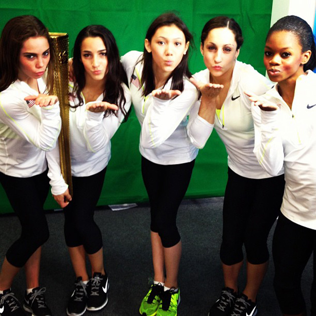 US Women's Gymnastics Team with the Olympic Torch