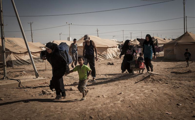 Syrian refugees carry their belongings to their tent after arriving at Za'atari refugee camp, Jordan.