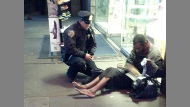 homeless guy boots ny cop