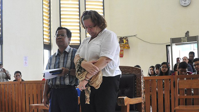 Lindsay Sandiford listens to interpreter at her verdict trial for smuggling cocaine into Bali