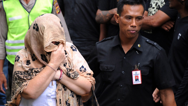 Lindsay Sandiford escorted by police after trial for smuggling cocaine into Bali