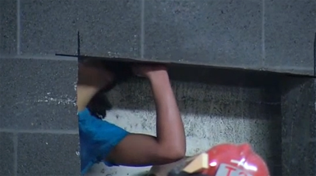 woman trapped between buildings rescue