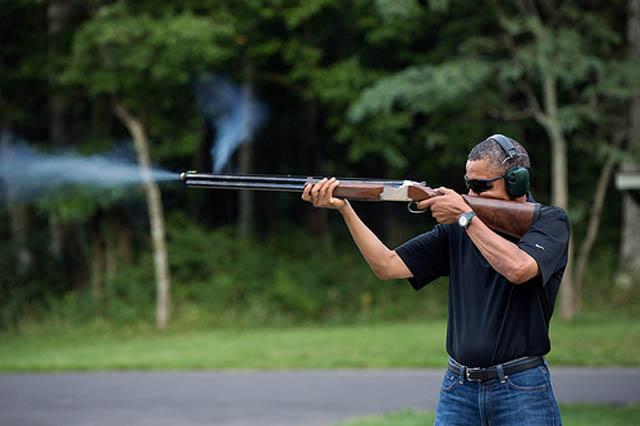 barack obama shoots gun shooting photo