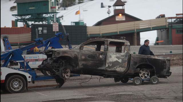 Christopher Jordan Dorner manhunt, Big Bear Lake, Nissan Titan Truck, burned out, door to door, San Bernadino County.