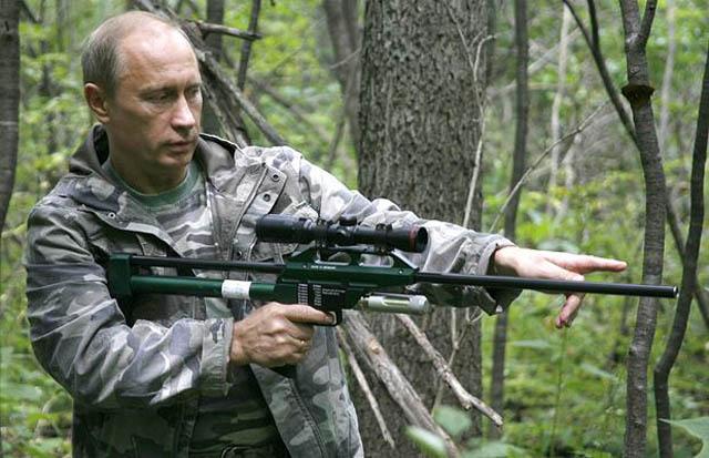 barack obama shooting gun photo
