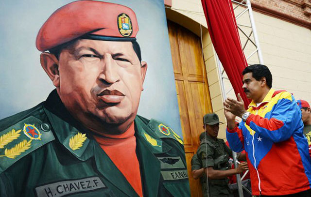 Maduro, in Chavez's typical tricolor tracksuit, praising a painting of Hugo Chavez