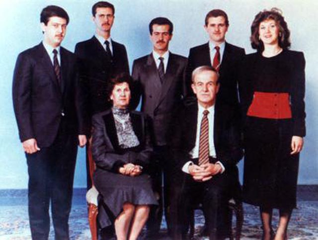 The al-Assad family in 1994 before Basel's death.  The Assad family. Hafez al-Assad and his wife, Mrs Anisa Makhlouf. On the back row, from left to right: Maher, Bashar, Basil, Majid, and Bushra al-Assad.