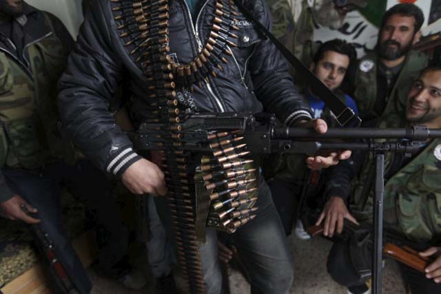 Free Syrian Army members (rebel group) at their base on/Getty Images