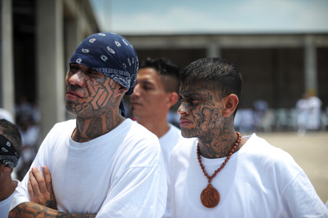 Members of the 18 street gang listen to a press conference at the yard of the jail in Izalco, 60 km west of San Salvador, El Salvador. Members of the 18 street gang handed over illegal items such as mobile phones and knives as part of the truce to stop gang crimes in El Salvador.        (Getty Images)