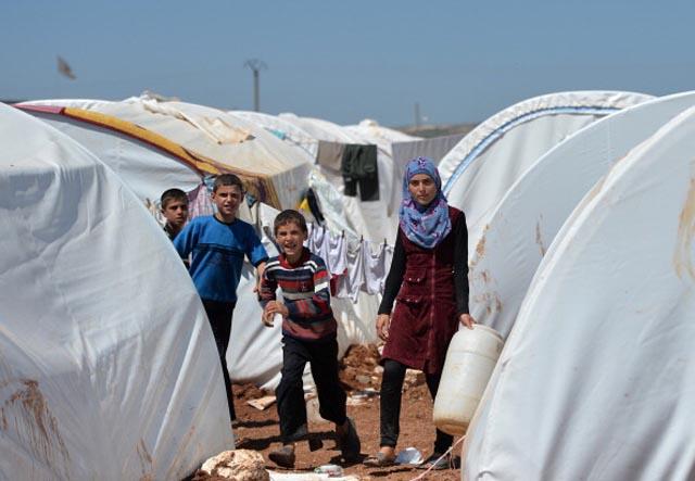 Refugees internally displaced  at the Maiber al-Salam refugee camp along the Turkish border  (Getty Images)