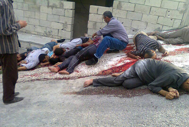 Citizen journalism image of the massacre released by a group that calls itself The Syrian Revolution Against Bashar Assad