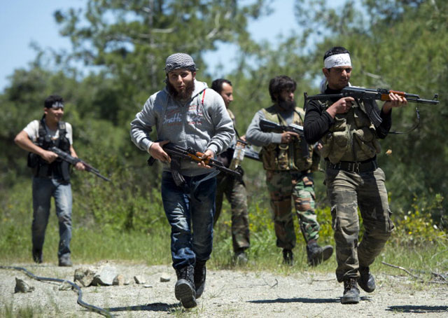 Rebel fighters from the Al-Ezz bin Abdul Salam Brigade attend a training session (Getty Images)