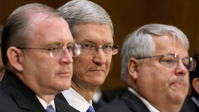 Apple head of tax operations Phillip Bullock, Apple CEO Tim Cook and Apple Senior Vice President and CFO Peter Oppenheimer. (Getty Images)