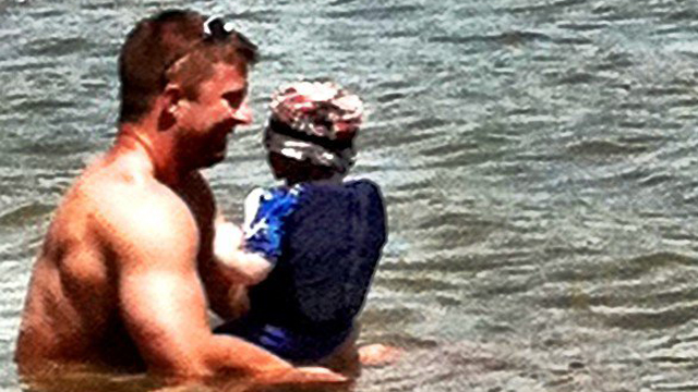 Finnerty in water with son