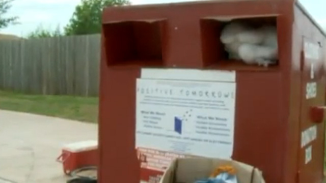 Woman Gets Stuck in Donation Box