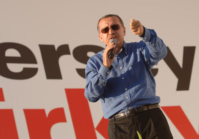 Turkish Prime Minister Tayyip Erdogan gestures to his supporters during a rally of his ruling AK Party (Getty Images)
