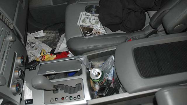 inside of the victim's Nissan Titan 4 pickup, showing the soda can where the cigarrette butt was found. (Marion County Sheriff's Office, Marion County Sheriff's Office)