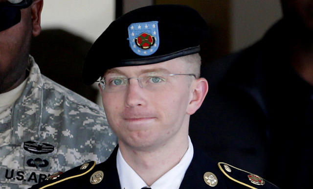 Bradley Manning being escorted out of a courthouse in Fort Meade, Md.  Manning is charged with aiding the enemy by causing hundreds of thousands of classified documents to be published on WikiLeaks.