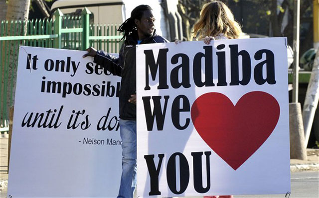 Supporters concentrate out of the hospital where Nelson Mandela remains in critical condition (Getty Images)