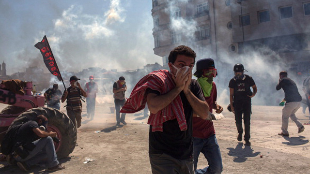 Protesters clash with riot police during a demonstration near Taksim Square (Getty Images)