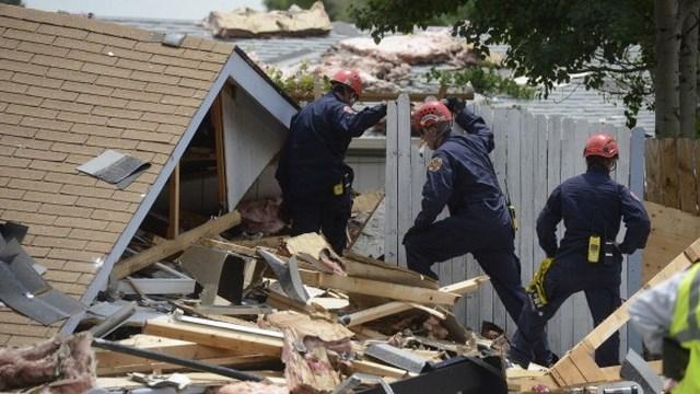 Emergency responders sift through debris. (Getty Images)