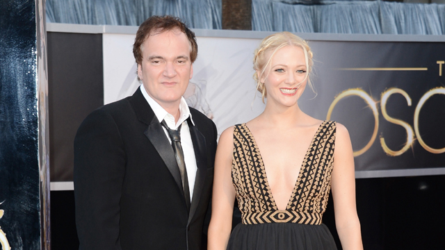 Director Quentin Tarantino and writer Lianne Spiderbaby arrive at the 2013 Oscars (Getty Images)