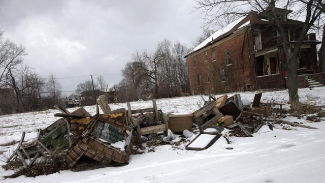 Trash is seen lying alongside a street in Detroit  (Getty Images)
