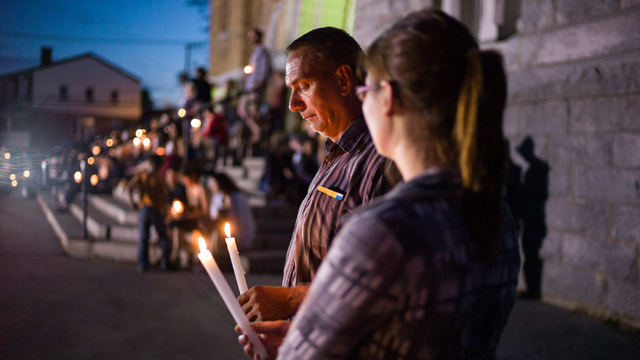 Local residents attend a public vigil at the Presbyteres-Eglises in Lac-Megantic, Quebec (Getty Images)
