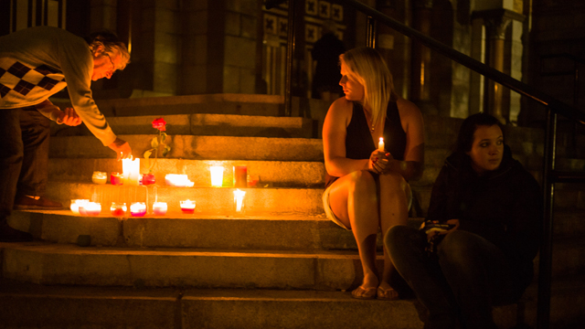 Local residents during a candle-lit vigil, at the Presbytres-Eglises Catholiques in Lac-Megantic, Quebec, Canada (Getty Images)