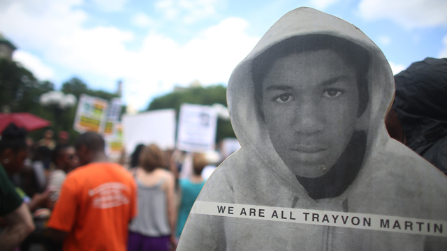 People gather at a rally honoring Trayvon Martin with his photo. (Getty Images)