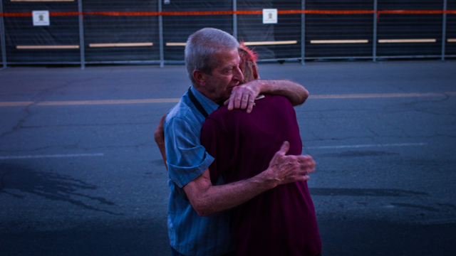 Marcel Larrivee (L) comforts Patricia Landry after the pair first witnessed the aftermath of the destruction (Getty Images)