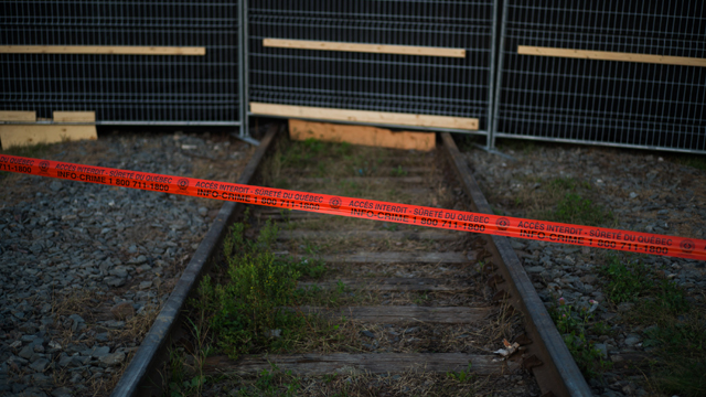 "Police tape marks the outside boundary of the ""red zone"" crash site (Getty Images)"