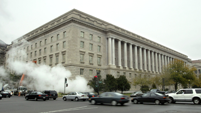 Steam rises from a grate outside the Internal Revenue Service headquarters building (Getty Images)