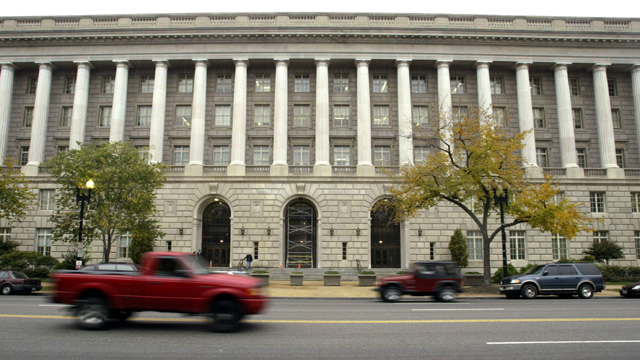 Cars drive past the Internal Revenue Service headquarters building (Getty Images)