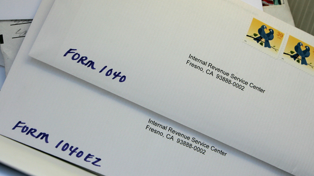 Letters to the Internal Revenue Service are piled up at the U.S. Post Office (Getty Images)