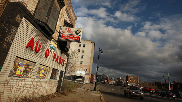 Shuttered businesses line on downtown Detroit street (Getty Images)