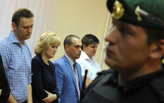 Russia's top opposition leader Aleksei Navalny stands in a courtroom in Kirov on July 18, 2013, as a Russian court delivers the verdict in the embezzlement trial of Navalny, an abrasive critic of President Vladimir Putin who risks years in prison and an end to his budding political career.  (Getty Images)