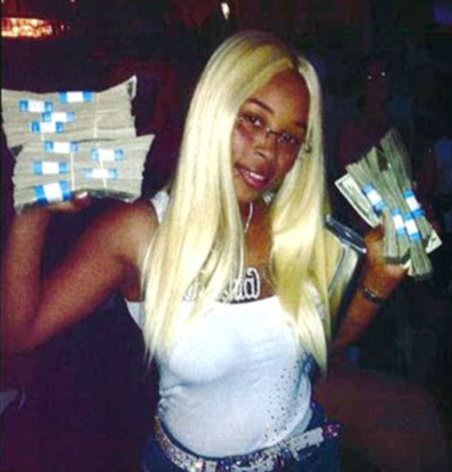 Rashia Wilson posing with money in a Facebook photo (Image courtesy of Tampa Bay Police Department)
