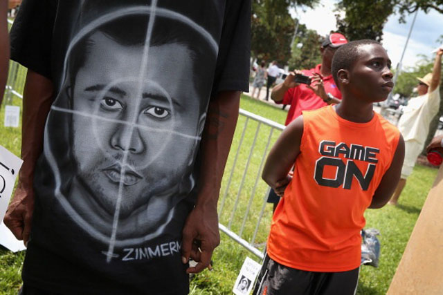 A demonstrator wears a shirt with a picture of George Zimmerman as a target during a protest in front of the Seminole County Criminal Justice Center  (Getty Images)