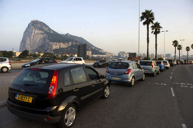 "Motorists wait in line at the border crossing between Spain and Gibraltar on Monday blasted a Spanish threat to impose a 50-euro ($66) car toll at the border with the tiny British-held territory as North Korean-style ""sabre rattling"".  It was the latest in a string of spats going back decades between Spain and Gibraltar, frequently sparked by disputes over fishing rights around the British outpost that Madrid wants to reclaim as its own.      (Getty Images)"