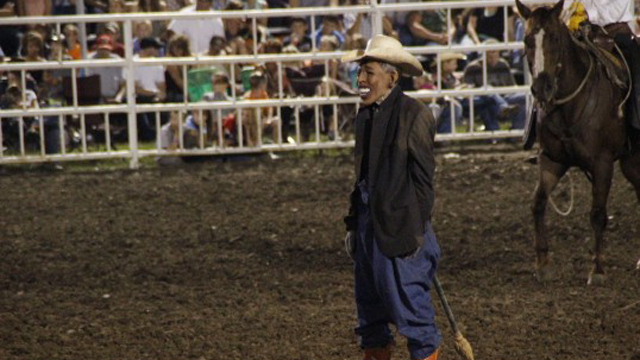 bull runs over obama, rodeo clown with obama mask