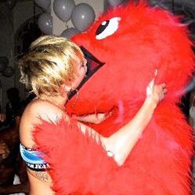 Miley Cyrus Tongue Red Furry Photos, Miley Cyrus Grinds Red Furry Animal Photos, Miley Cyrus Makes Out Kissing Red Furry Animal