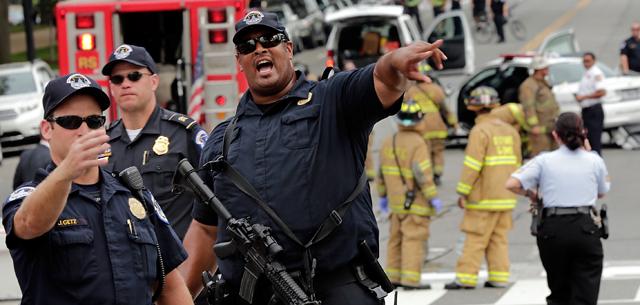 Police guns drawn Capitol Building shooting.