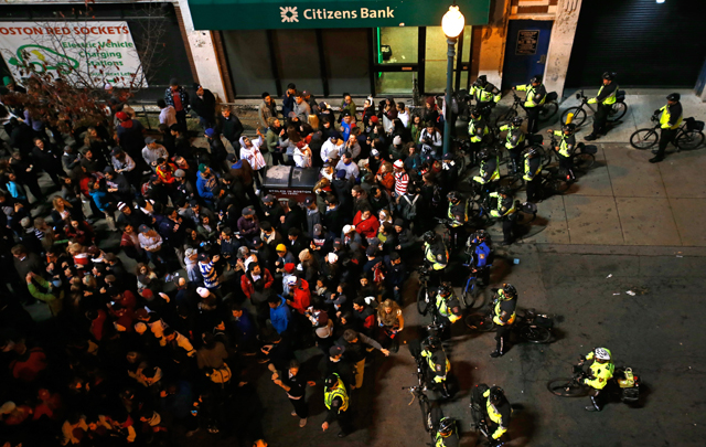 BOSTON, MA - OCTOBER 30: Boston Police officers move fans away from Fenway Park during Game Six of the 2013 World Series between the Boston Red Sox and the St. Louis Cardinals on October 30, 2013 in Boston, Massachusetts. (Photo by Jim Rogash/Getty Images)