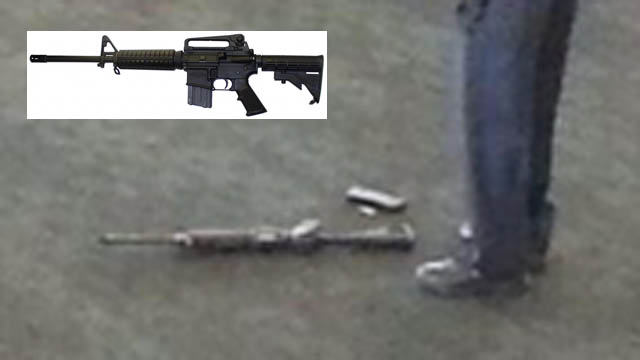 The possible weapon used in today's LAX shooting spree lies on the ground near the foot of an investigator. Reports suggest it was an AR-15 rifle. INSET: An AR-15.