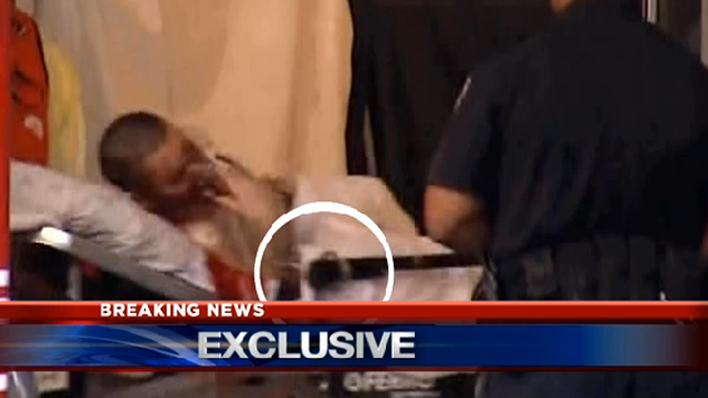 CAL has uncovered within their footage this image of an injured man who appears to be handcuffed to the gurney. (KCAL screenshot)