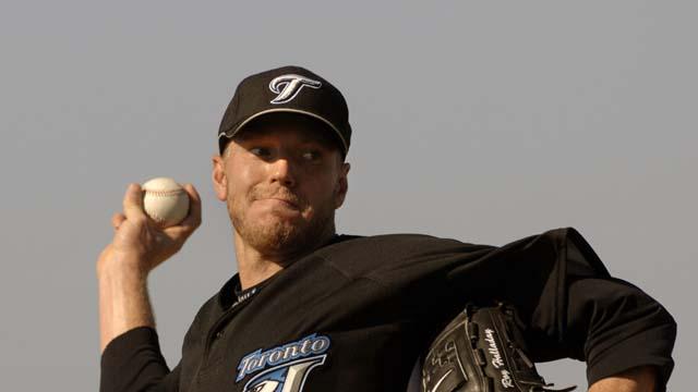 Roy Halladay reties, Phillies, Blue Jays