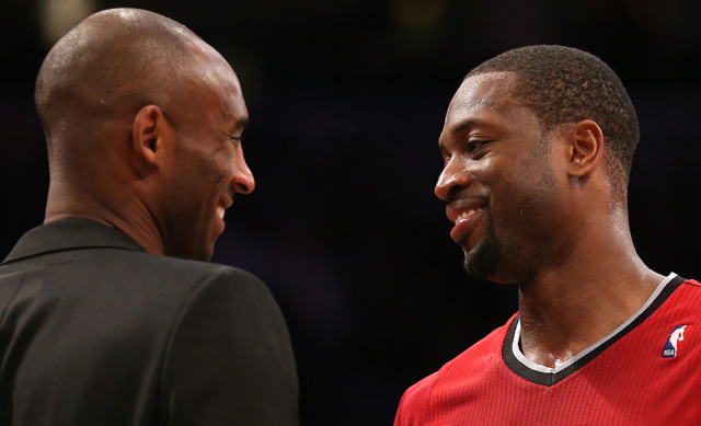 Dwyane Wade talks with Kobe Bryant after the game at Staples Center on December 25, 2013. Wade reportedly visited his baby son while in town for the game. (Getty)