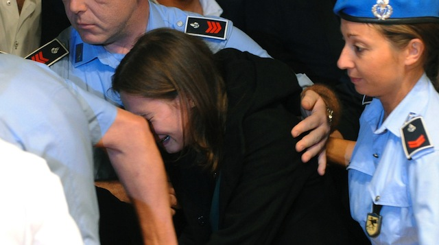 October 2011, Amanda Knox breaks down in tears after hearing the verdict that overturns her conviction and acquits her of murder. (Getty)