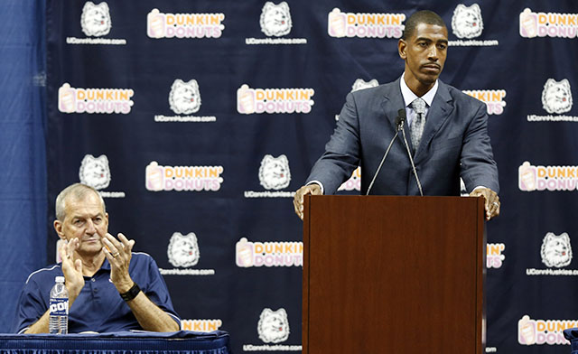With Jim Calhoun looking on, Ollie was introduced as UConn's head coach on Sept. 13, 2012. (Getty)